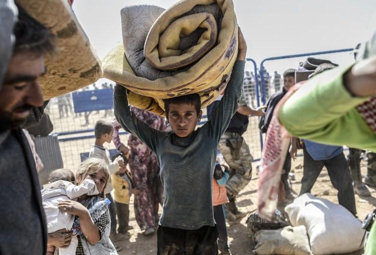 Image: TOPSHOTS-SYRIA-TURKEY-IRAQ-KURDS-CONFLICT-REFUGEES