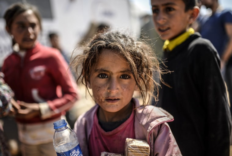 Image: SYRIA-TURKEY-IRAQ-KURDS-CONFLICT-REFUGEES