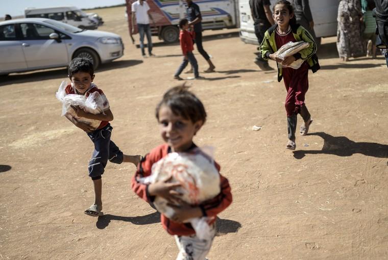 Image: TURKEY-SYRIA-KURDS-CONFLICT-REFUGEES