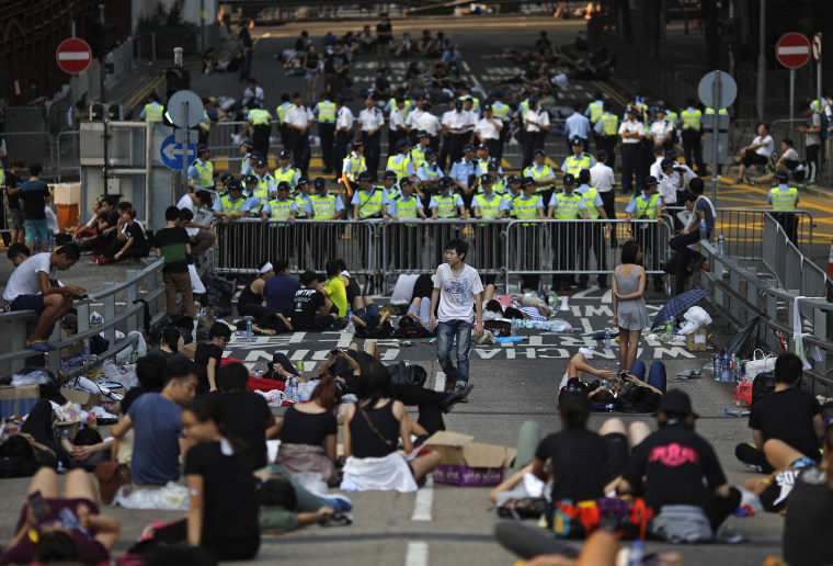 Image: Protesters block a street near government headquarters in Hong Kong