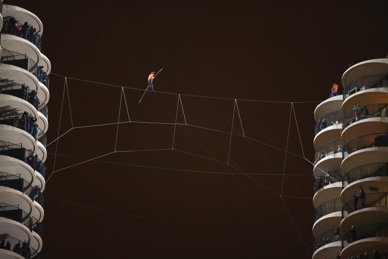 Image: Daredevil Nik Wallenda Walks Across Tightrope In Between Downtown Chicago Buildings