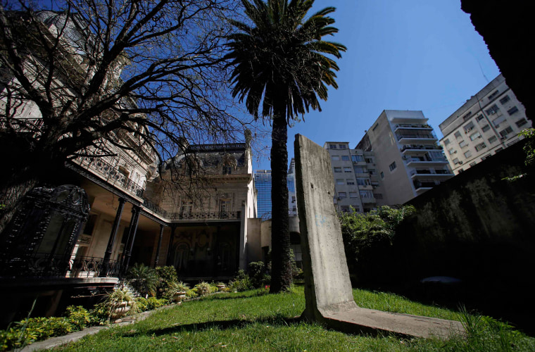 Image: A piece of the Berlin Wall is seen at a garden inside San Martin palace, headquarters of Argentina's Foreign Ministry in Buenos Aires