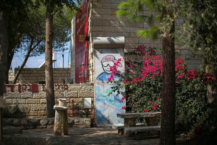 Image: A piece of the Berlin Wall is seen in the artists' village of Ein Hod near Haifa in Israel