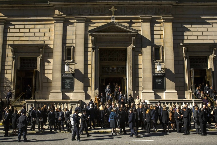 Image: Mourners file out of Church of St. Ignatius Loyola following  memorial service for de la Renta in New York