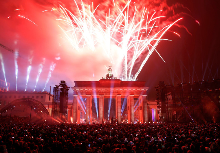 Image: Fireworks explode above Brandenburg Gate during celebrations to mark 25th anniversary of the fall of the Berlin Wall