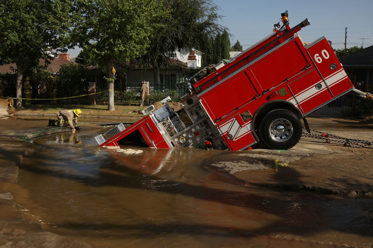 Image: Fire Truck Trapped In Giant Sinkhole