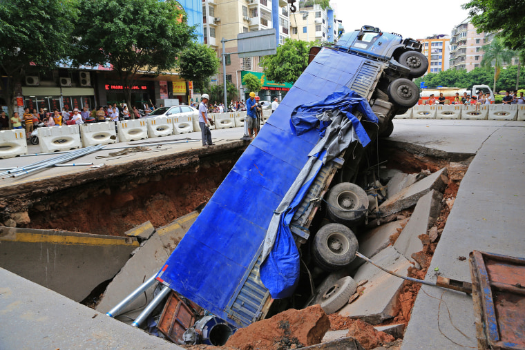 Sinkhole swallows truck in south China