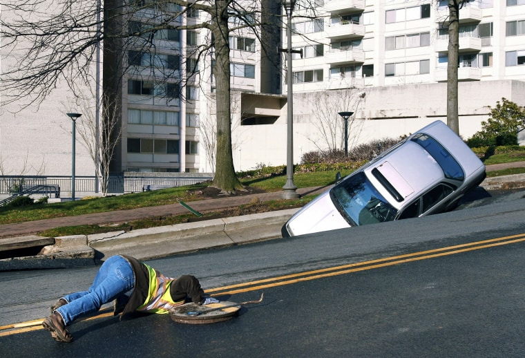 Image: Sink Hole Swallows Car In Chevy Chase, Maryland