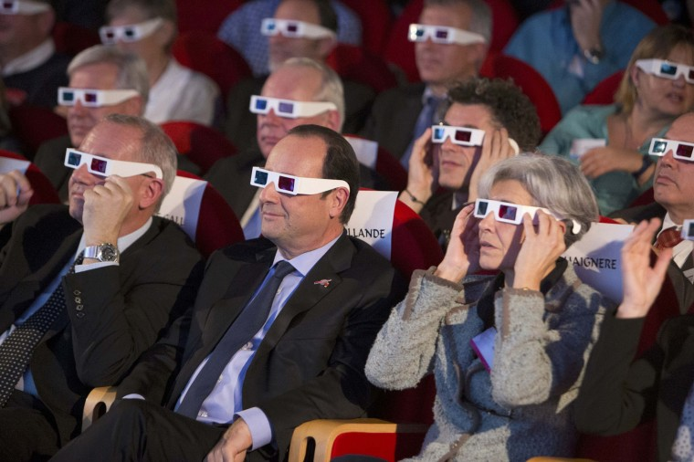 Image: CNES President Le Gall, French President Hollande and former French astronaut Haignere wear 3D glasses during a visit at the Cite des Sciences at La Villette in Paris