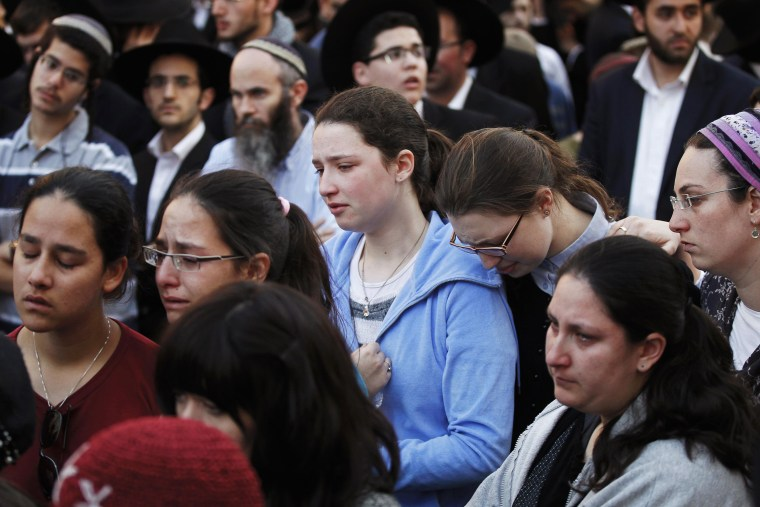 Image: Israeli ultra-Orthodox Jews mourn during the funeral of Kopinsky, Levine and Goldberg in Jerusalem