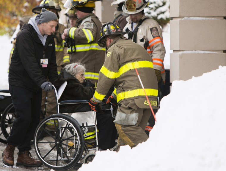 Image: Firefighters from Cheektowaga and Depew attend to patients from from Garden Gate Health Care Facility in the town of Cheektowaga near Buffalo, New York