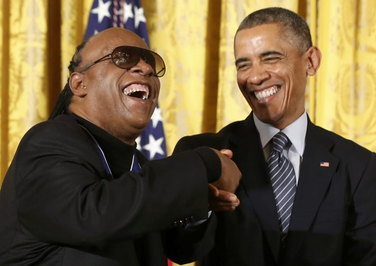 Image: Singer Stevie Wonder is greeted by U.S. President Obama after receiving the Presidential Medal of Freedom during a White House ceremony in Washington