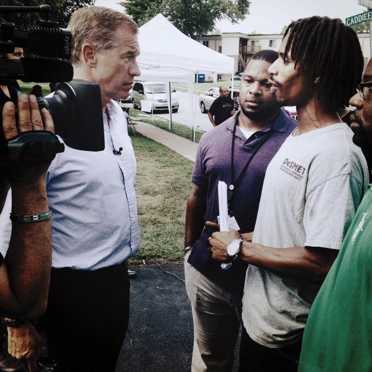 Image: Speaking with a resident of Ferguson, during the tense days of civil unrest after the killing of Michael Brown.  Ferguson, MO, August 2014