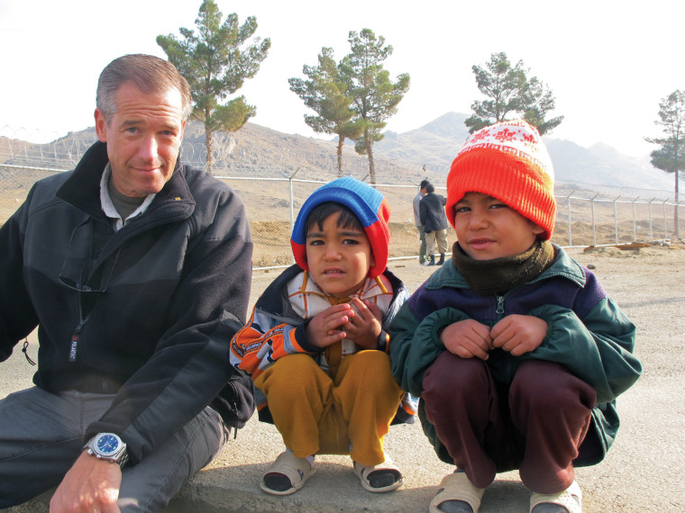 Image: A moment spent with local Afghan boys. Afghanistan, October 2009