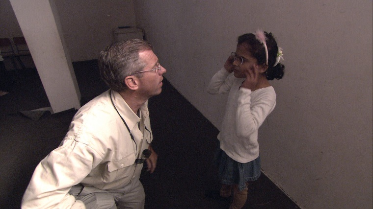 Image: Swapping glasses with Shogofa, an Afghan girl, in the AFCECO orphanage. Kabul, Afghanistan, October 2009