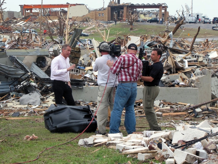 Image: Amidst the destruction after tornado leveled the town of Joplin, MO, May 2011.