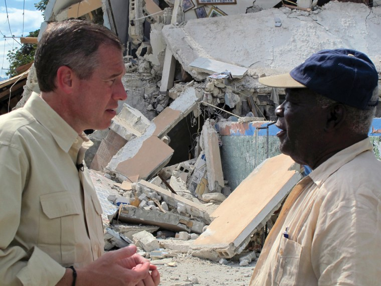 Image: Speaking with a Port-au-Prince resident in aftermath of the earthquake. Haiti, January 2010.