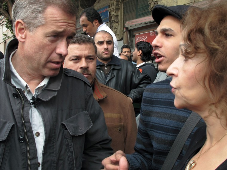 Image: Speaking with citizens during the Egyptian Revolution. Cairo, Egypt, February 2011