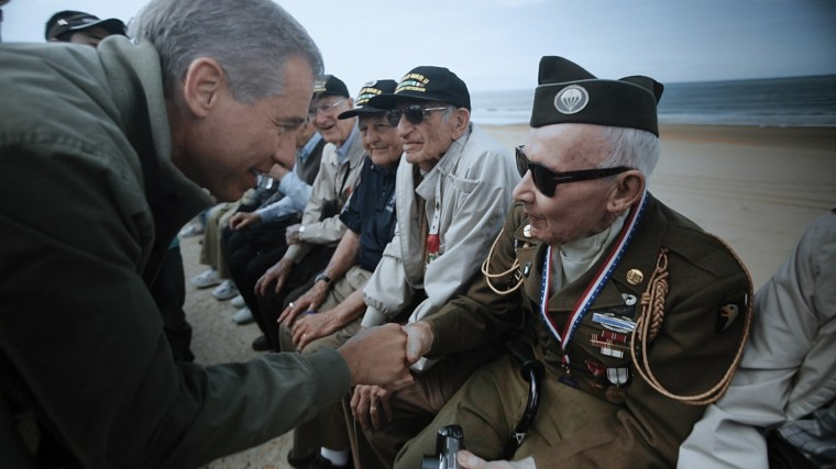 Image: Paying tribute to veterans during the commemoration of the 70th anniversary of D-Day. Omaha Beach, June 2014.
