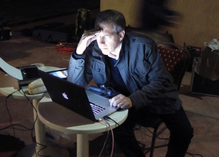 Image: Preparing for broadcast from a makeshift newsroom during the height of the uprising in Tahrir Square. Cairo, Egypt, February 2011