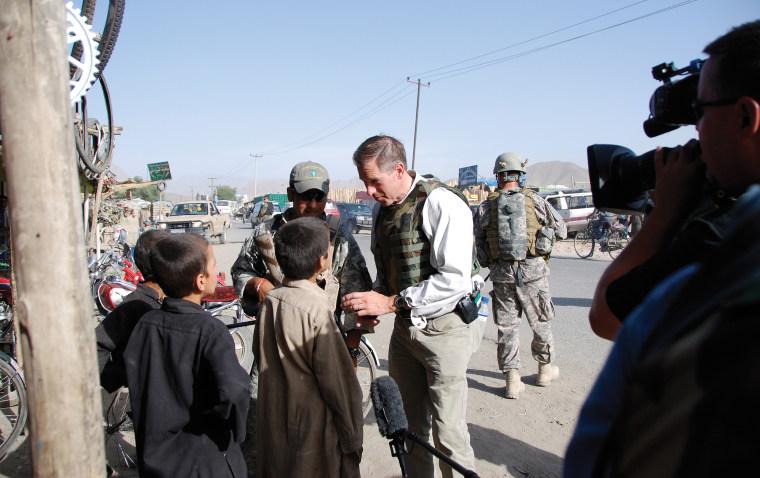 Image: Meeting children, accompanied by an Afghan Commando, near Camp Morehead. Kabul, Afghanistan, June 2008