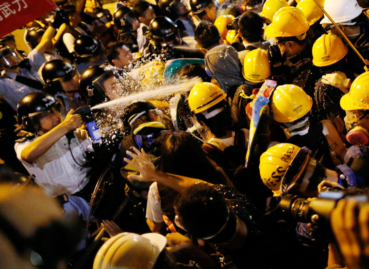 Image: Police use pepper spray during clashes with pro-democracy protesters close to the chief executive office in Hong Kong