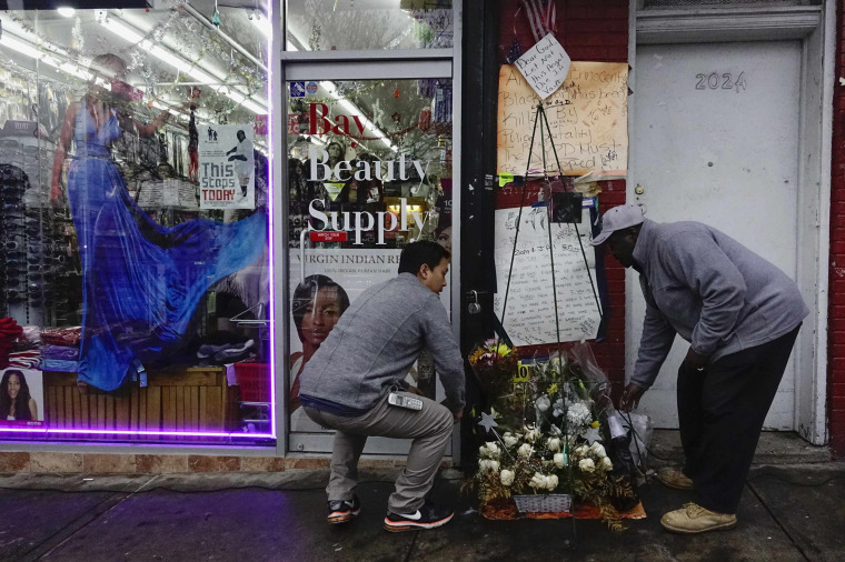 Image: People visit the makeshift memorial where Eric Garner died during an arrest in July, at the Staten Island borough of New York