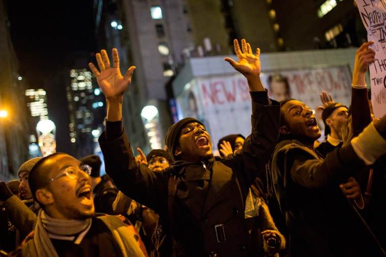 Image: People take part in a protest against the grand jury decision on the death of Eric Garner in midtown Manhattan in New York