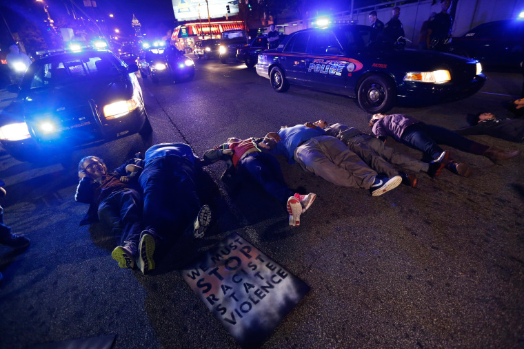 Image: People Protest over no indictment in Eric Garner's chokehold case in Atlanta, Georgia