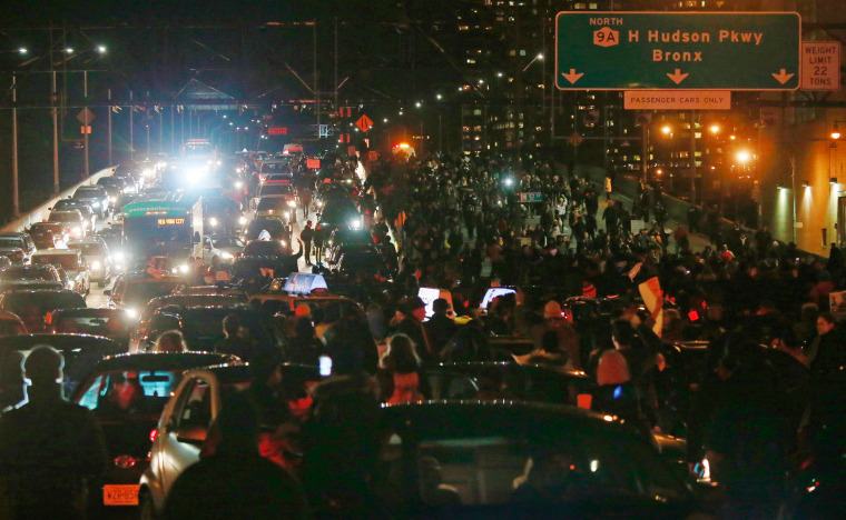 Image: Demonstrators block the West Side Highway during a protest against the grand jury decision on the death of Eric Garner, in New York