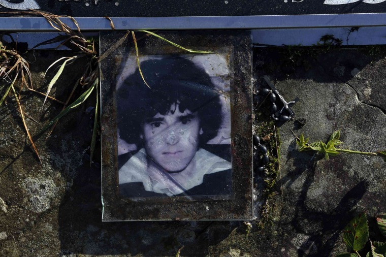 Image: A memorial for Brian McKinney is seen at the site where his body was discovered at Colgagh bog, Inniskeen