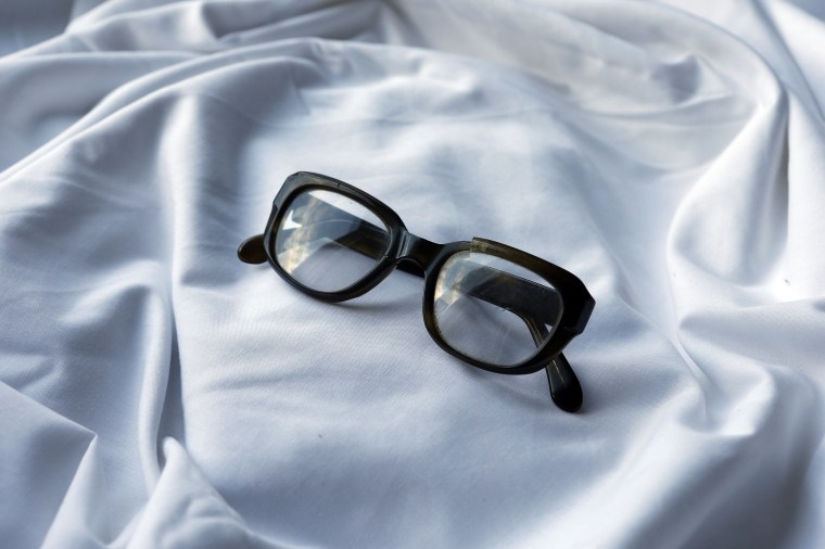 Image: A pair of glasses which were discovered in Seamus Ruddy's Paris apartment after he went missing are displayed in his sister Anne Morgan's house in Newry, County Down