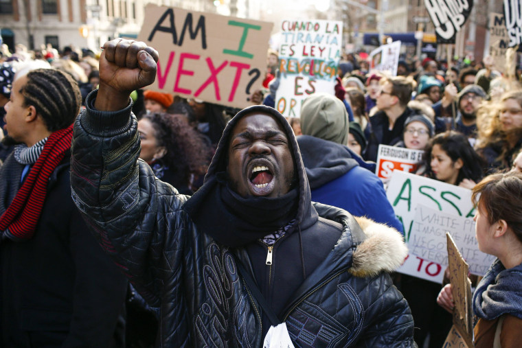 Image: People shout slogans against police as they take part in a march against police violence, in New York