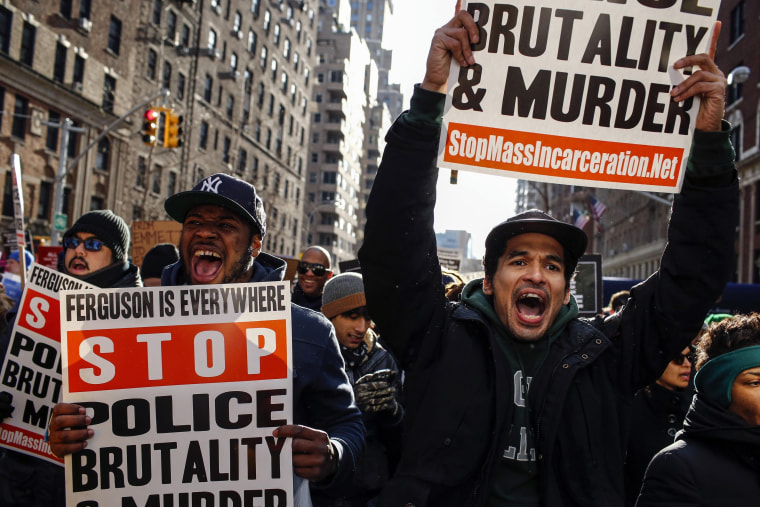 Image: People shout slogans agains police as they take part in a march against police violence, in New York