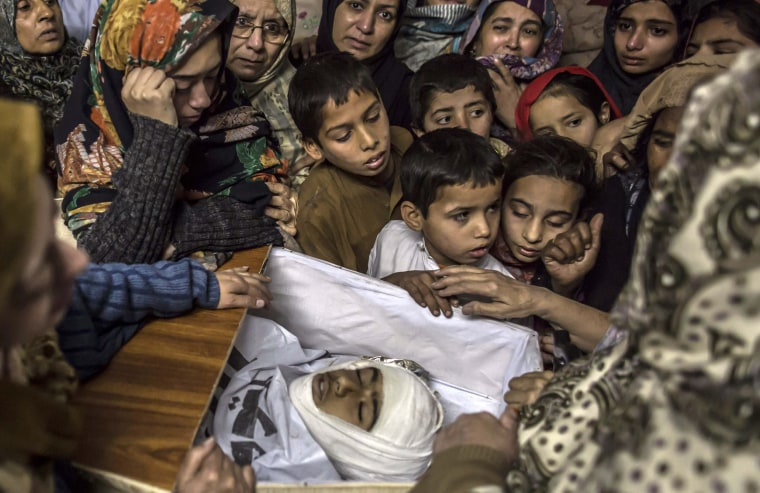 Image: Children are seen beside their relative Mohammed Ali Khan, a student who was killed during an attack by Taliban gunmen on the Army Public School, at his house in Peshawar
