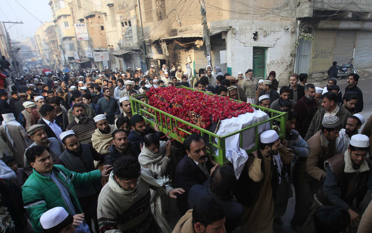 Image: People carry the coffin of a male student who was killed in Tuesday's attack on the Army Public School, during his funeral in Peshawar