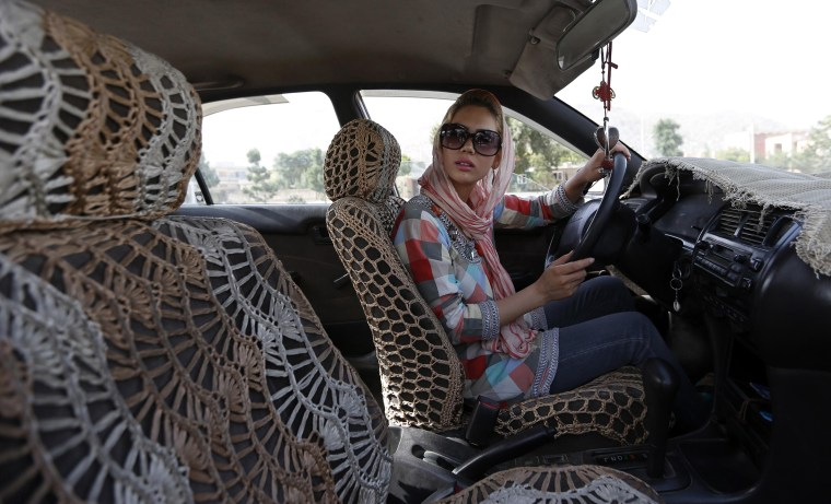 Image: Kanaz listens to her instructor during a practical driving test in Kabul