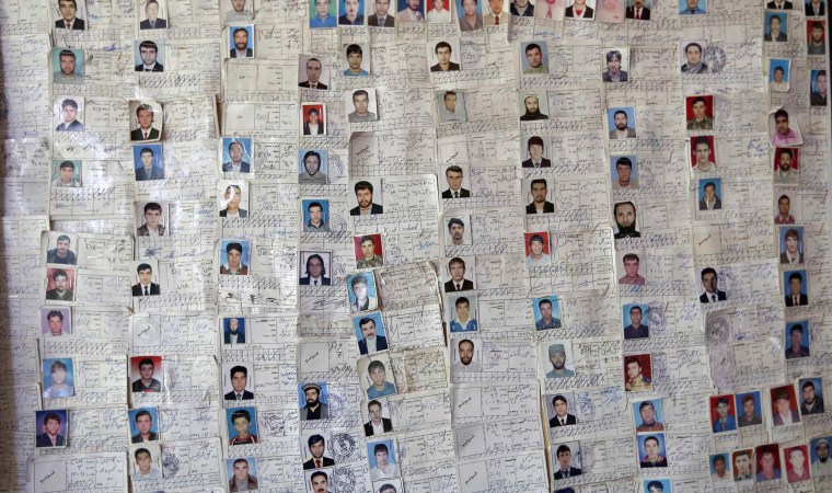 Image: A chart of students who completed their training is seen on a wall at a driving school in Kabul