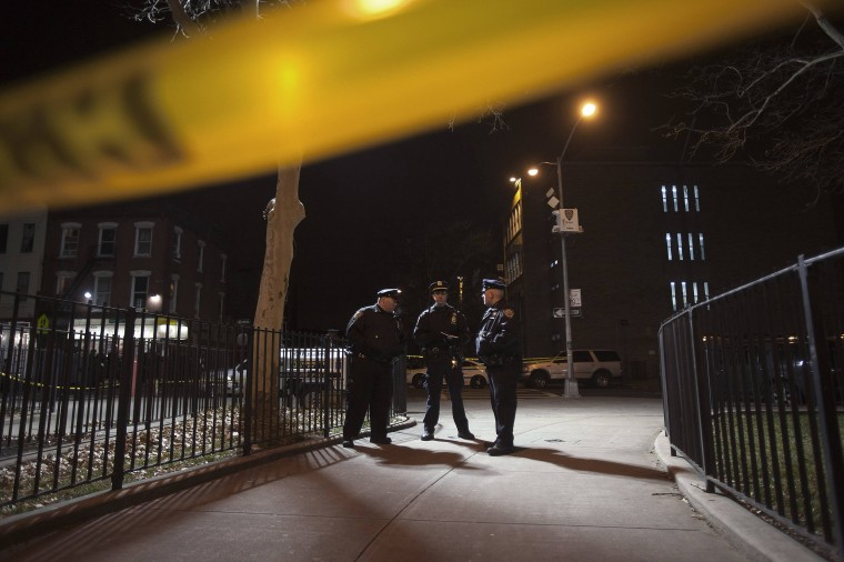 Image: Police are pictured at the scene of a shooting where two New York Police officers were shot dead in the Brooklyn borough of New York