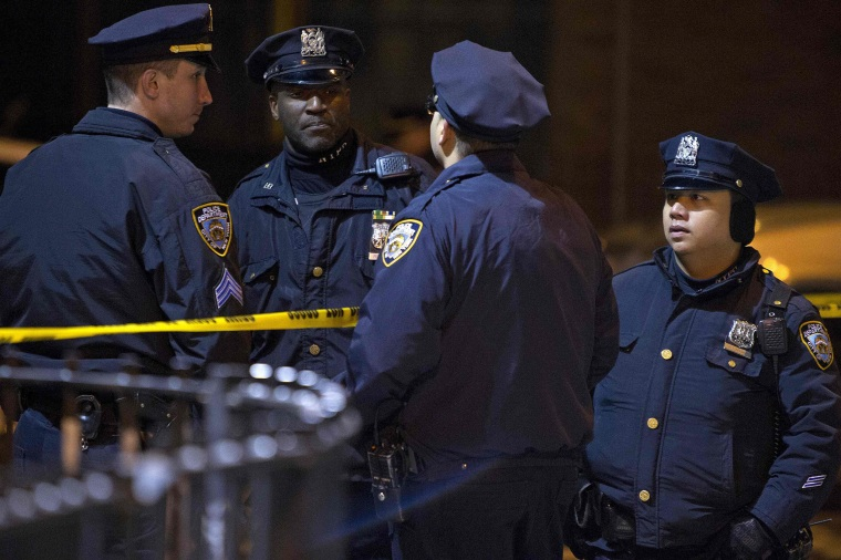Image: Police are pictured at the scene of a shooting where two New York Police officers were shot dead in Brooklyn, New York