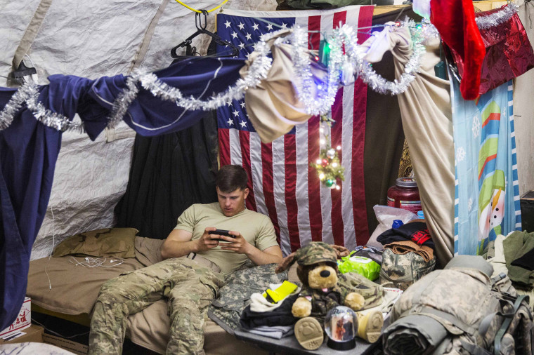 Image: U.S. soldier from the 3rd Cavalry Regiment relaxes in his quarters after taking part in a mortar exercise on forward operating base Gamberi in the Laghman province of Afghanistan