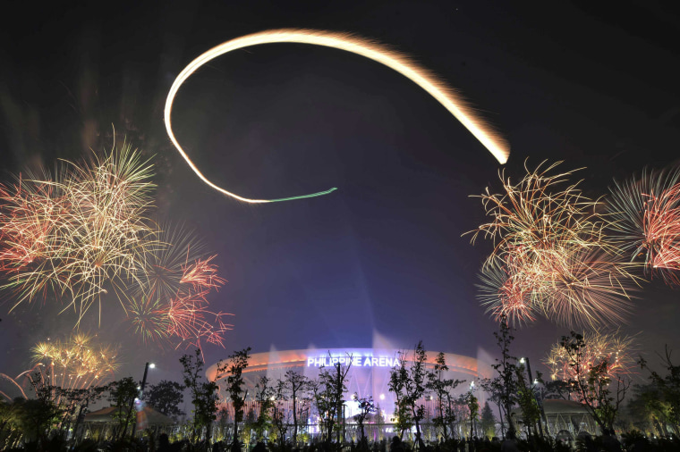 Image: Spectators watch as fireworks light the sky during New Year celebrations outside the Philippine Arena in Bocaue town