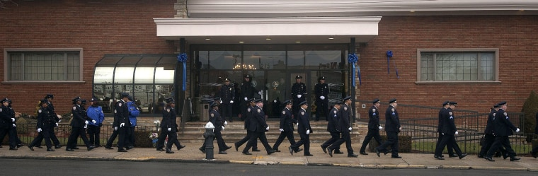 Image: Members of the 84th Precinct arrive for the wake of slain NYPD officer Wenjian Liu in the Brooklyn borough of New York
