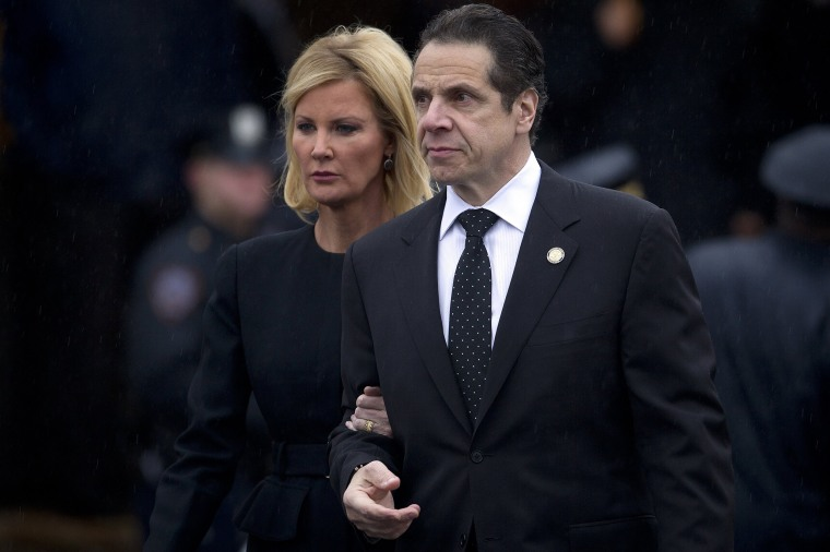 Image: New York Governor Cuomo and his partner Lee depart the wake for slain New York Police Department officer Liu in the Brooklyn borough of New York
