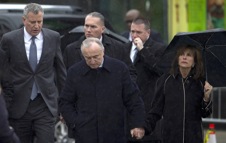Image: New York Police Commissioner Bratton, his wife Klieman and New York City Mayor de Blasio depart from the wake for NYPD officer Liu in the Brooklyn borough of New York