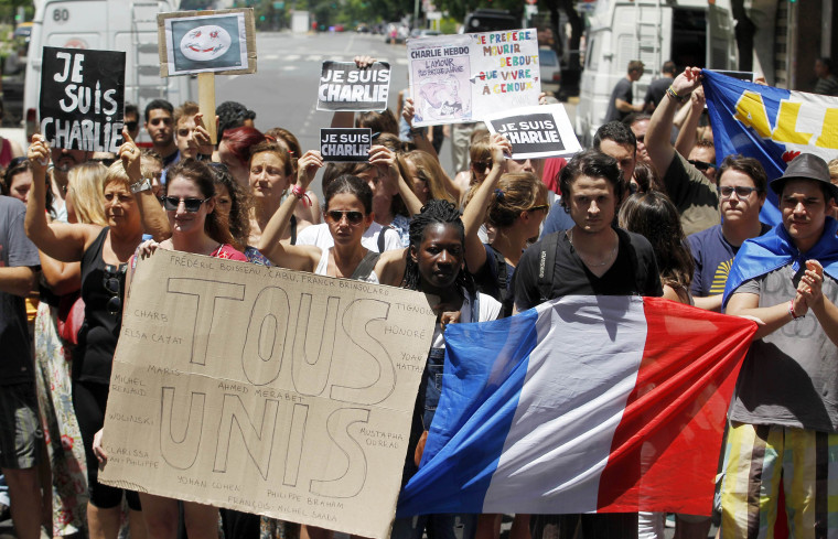 Image: People march towards the French embassy during a rally to pay tribute to the victims of the shootings in France at the offices of the satirical weekly newspaper Charlie Hebdo and a kosher supermarket, in Buenos Aires