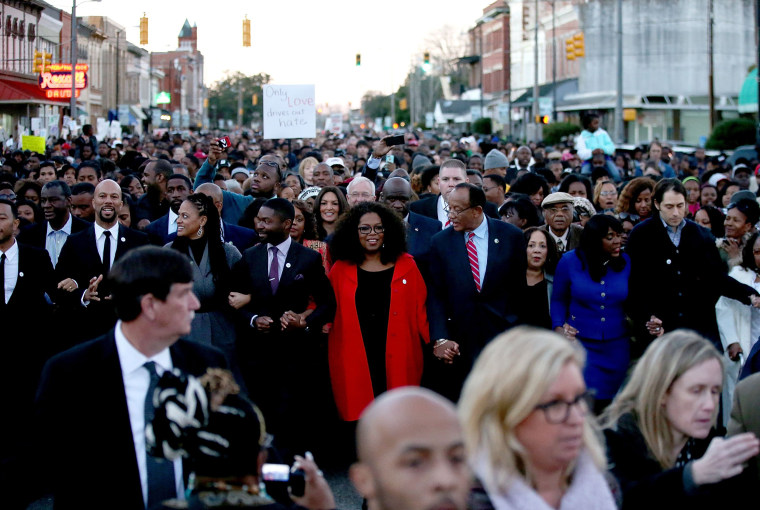Image: Members Of The Cast From Movie Selma March Over Edmund Pettus Bridge