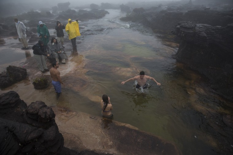 Image: Tourists bathe on a river at the top of Roraima Mount, near Venezuela's border with Brazil
