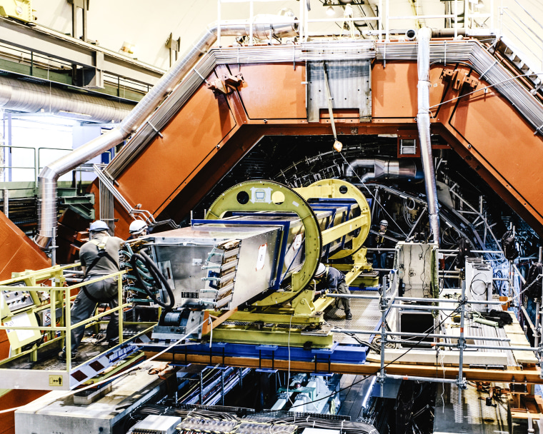 Last maintenance work inside the ALICE experiment. before running again in 2015 after a 2-year technical stop of the LHC.  The ALICE collaboration uses the 10,000-tonne ALICE detector ? 26 m long, 16 m high, and 16 m wide ? to study quark-gluon plasma. ALICE (A Large Ion Collider Experiment) is a heavy-ion detector on the Large Hadron Collider (LHC) ring. It is designed to study the physics of strongly interacting matter at extreme energy densities, where a phase of matter called quark-gluon plasma forms. The detector sits in a vast cavern 56 m below ground close to the village of St Genis-Pouilly in France, receiving beams from the LHC. The collaboration counts more than 1000 scientists from over 100 physics institutes in 30 countries.
