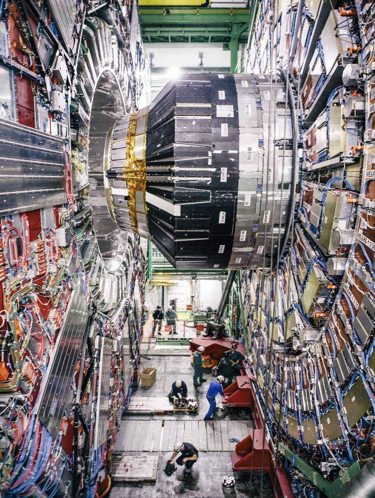 Last maintenance work inside The Compact Muon Solenoid (CMS), a general-purpose detector at the Large Hadron Collider (LHC). It is designed to investigate a wide range of physics, including the search for the Higgs boson, extra dimensions, and particles that could make up dark matter. Although it has the same scientific goals as the ATLAS experiment, it uses different technical solutions and a different magnet-system design. The CMS detector is built around a huge solenoid magnet. This takes the form of a cylindrical coil of superconducting cable that generates a field of 4 tesla, about 100,000 times the magnetic field of the Earth. The field is confined by a steel ?yoke? that forms the bulk of the detector?s 12,500-tonne weight. An unusual feature of the CMS detector is that instead of being built in-situ like the other giant detectors of the LHC experiments, it was constructed in 15 sections at ground level before being lowered into an underground cavern near Cessy in France and reassembled. The complete detector is 21 metres long, 15 metres wide and 15 metres high. The CMS experiment is one of the largest international scientific collaborations in history, involving 4300 particle physicists, engineers, technicians, students and support staff from 182 institutes in 42 countries (February 2014).